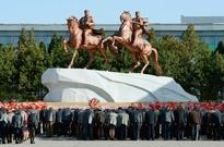 Kim Jong un orders drivers in North Korean capital to drive REALLY slowly by statue of his dad