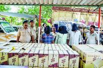 Police seize liquor cartons