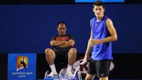 Tomic sticking with father as coach