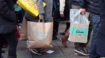 In pictures: Christmas shoppers hit Oxford Street in central London for the first Sunday in December