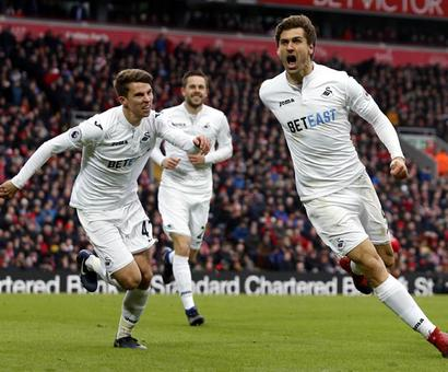 Liverpool title challenge dented by Swansea