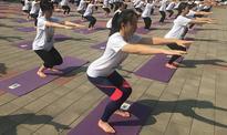 500 salute sun in Beijing for International Yoga Day