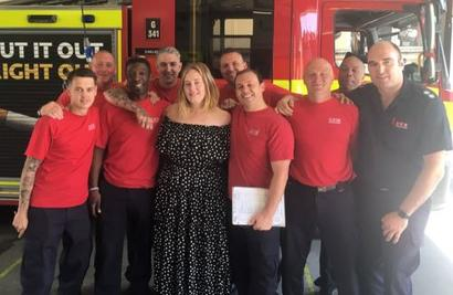 Adele shares a cuppa with London fire brigade heroes