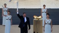 Olympic torch lit at Panathinean stadium in Athens
