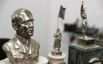 Hitler bust and swastikas found among Argentina's biggest hidden stash of Nazi memorabilia
