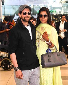 PIX: Newlyweds Neil-Rukmini return to Mumbai