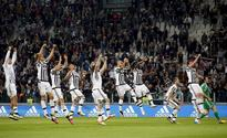 Juventus nears title; Totti puts on a show for... Juventus' players celebrate their win at the end of the match. REUTERS/A...