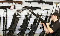 American gun fanatics buy heavy duty weapons fearing Hillary Clinton will sweep the US elections
