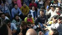 JNU students and Journalists protesting at Delhi police headquarters against manhandling and lathi charge