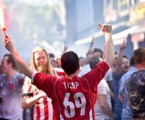 PSV pip Ajax for Eredivisie title A PSV Eindhoven's supporter celebrates with a torch after his team won a...