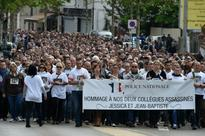 Hundreds in silent march for slain French police couple