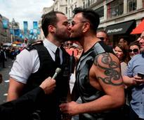 Two police officers stopped London Pride Parade to propose to their boyfriends...and they both said yes