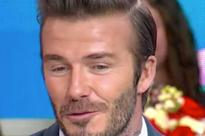 David Beckham denies 'pimping out' Cruz - saying 11-year-old son wanted to do charity song to 'give back'