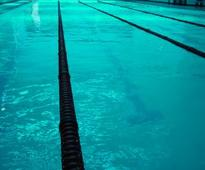 Swimmers stand by rape-tainted coach