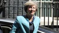 Fidelity backs May's executive pay plan
