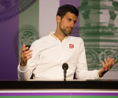 Laver's record safe as Djokovic feels weight of history