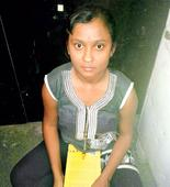 Woman studies for CA in Yerawada Central Jail