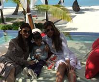 Big B posts adorable picture of Aishwarya, Aaradhya