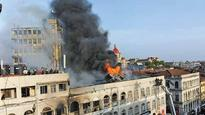 Fire burns Metro House in Colaba Causeway