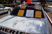 Photos from Tucson shooting show patrol car as makeshift whiteboard, high-capacity magazines