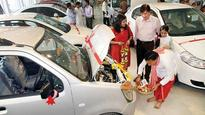 Crowded auto showrooms see cracker of sales