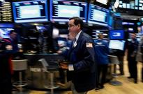 Dow, S&P notch record closes on dimmed rate hike prospects