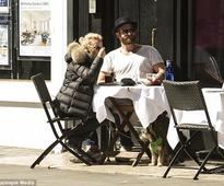 Kylie Minogue looks blissfully happy as she enjoys al fresco London lunch