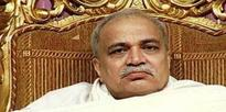 Retired professor held on charges of blackmailing Nirmal Baba