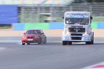 BMW 1M vs. a race truck  VIDEO