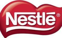 Nestle, on health kick, moves into milk allergy testing