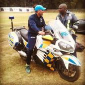 MS Dhoni Borrows A Police Motorcycle From A Zimbabwean Cop Shows Up On The Field Riding It