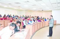 XLRI biz seminar bridges great divide