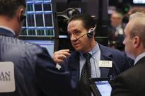 Wall St. rebounds but dollar falls and oil touches 11-year low
