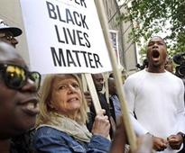 In police cases, black activists push reforms outside court