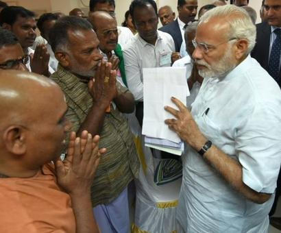 PM visits Ockhi affected areas, announces relief measures