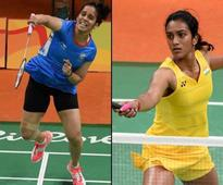Shuttlers Saina, Sindhu lose in All England quarters