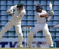 Mendis ton revives Lanka hopes against Aussies Sri Lanka's Kusal Mendis (R) plays a shot as Australian wicketkeeper Pet...
