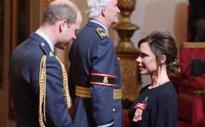 I'm proud to be British, says Victoria Beckham, after receiving OBE from Prince William