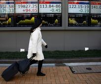 Asian stocks briefly hit two-year highs as outlook darkens