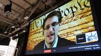 Snowden: Petraeus disclosed more 'highly classified' information than I did