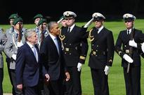 President Obama walks with German President Joachim Gauck at the Schloss Bellevue in Berlin.