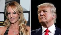 Documents link Trump Organization lawyer's effort to silence porn star Stormy Daniels