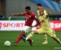 Guangzhou Evergrande edges past Club America to face Barca