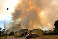 Heat wave causes California wildfire to worsen, threatening homes