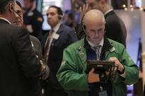 Bank stocks bring down S&P, Dow; techs prop up Nasdaq