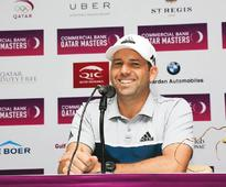 Windy Doha a concern for title favourite Garci... Spain's Sergio Garcia gestures at a press conference ahead of the Qata...