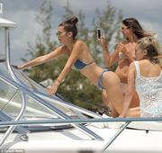 Bella Hadid grabs Hailey Baldwin's rear as the bikini babes enjoy their Caribbean getaway