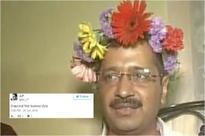 Kejriwal trolled for wearing a coronet of flowers