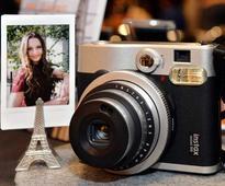 Japan camera makers battle smartphone onslaught ...