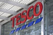 Tesco Swaps Global Aspirations for Giraffe Amid Profit Slide